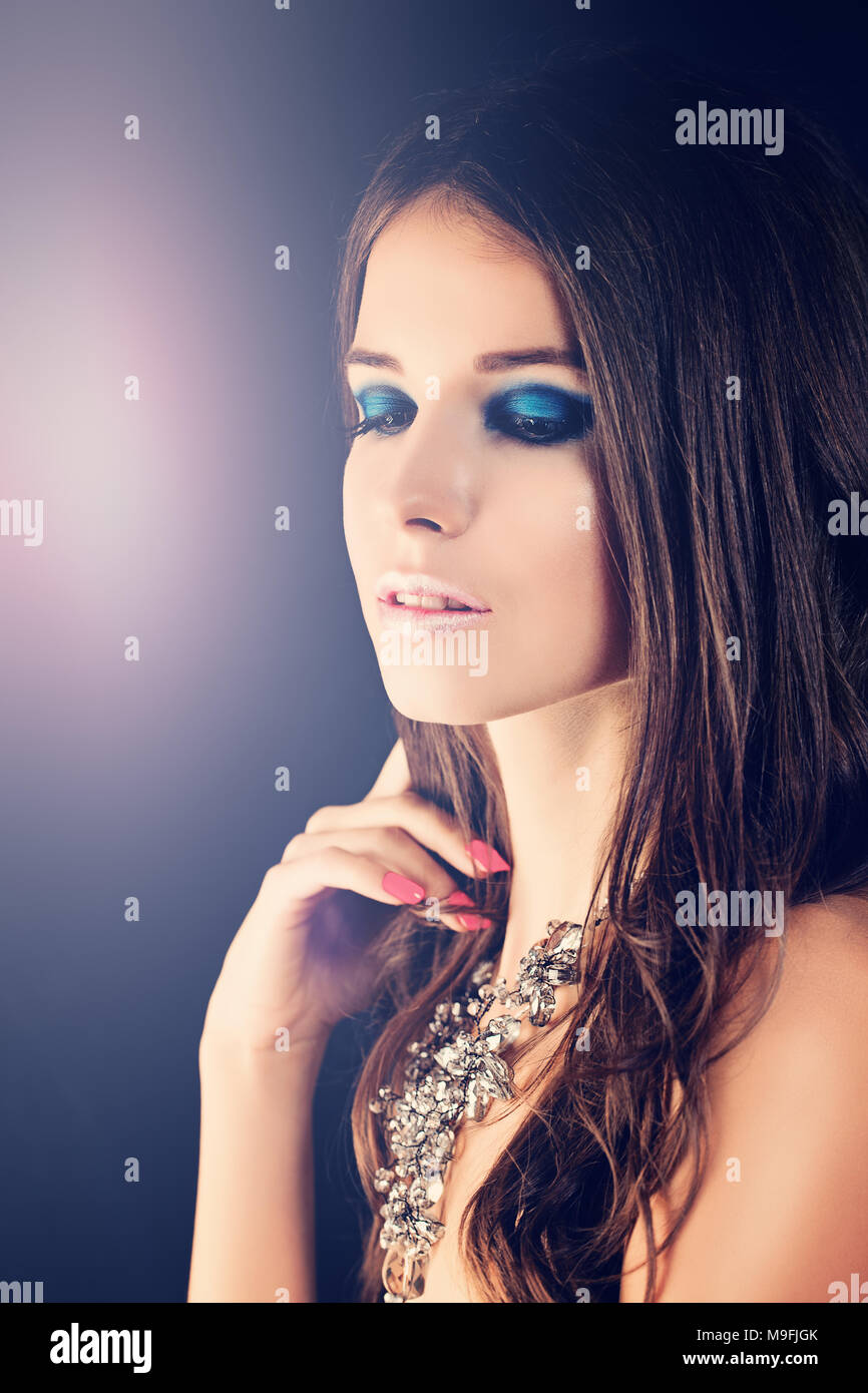 Beautiful Girl. Fashion Makeup, Long Brown Hair and Necklace - Stock Image