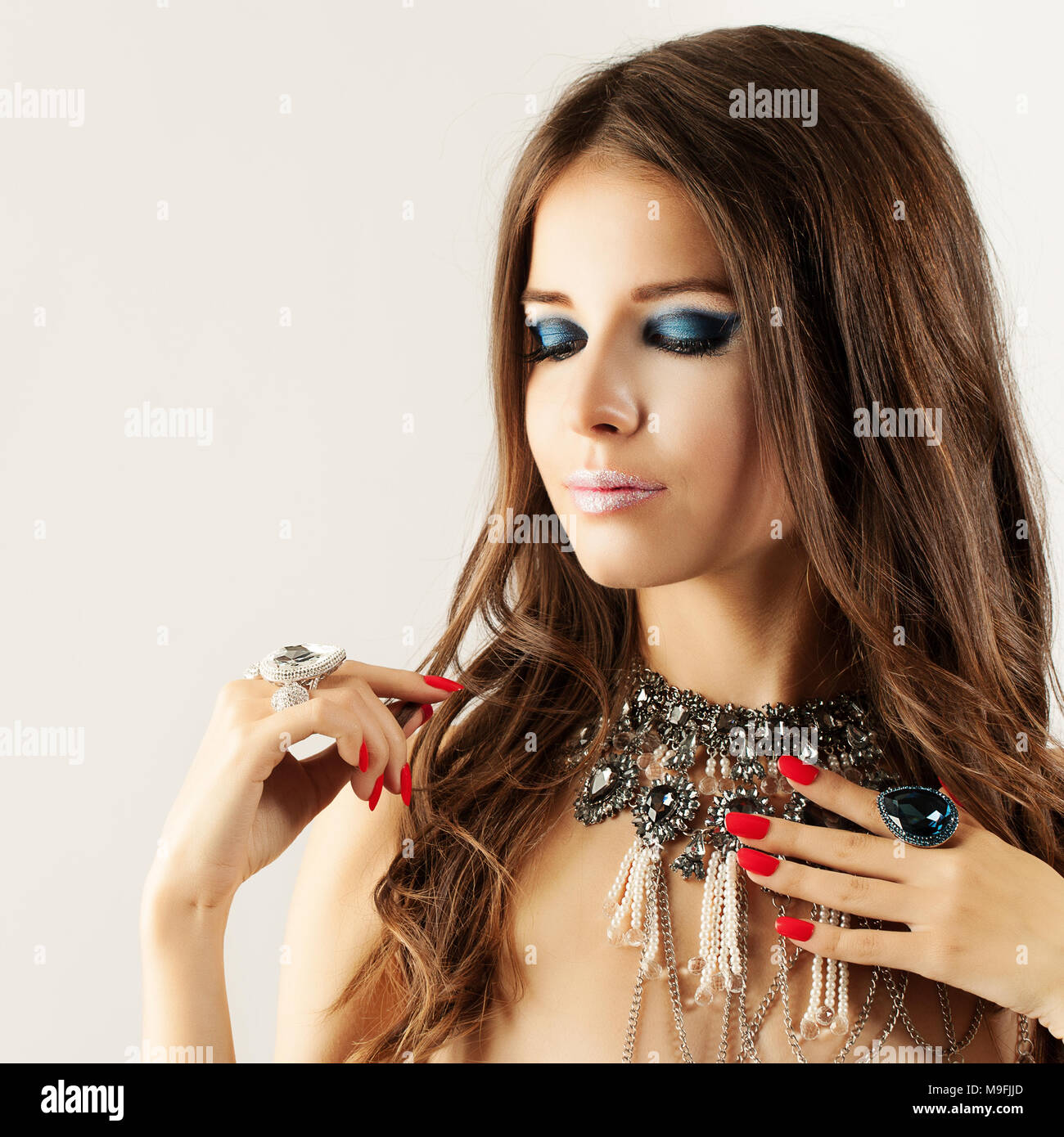 Fashion Girl With Makeup Manicure Nails And Jewelry Woman With Curly Hair And Bright Makeup
