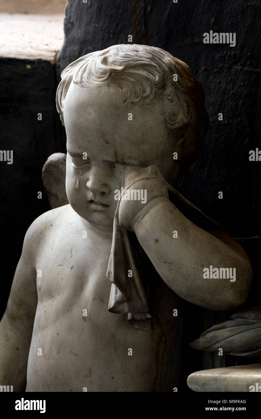 A weeping cherub on the monument of Robert Berkeley (1650-1694) , All Saints Church, Spetchley, Worcestershire, UK - Stock Image