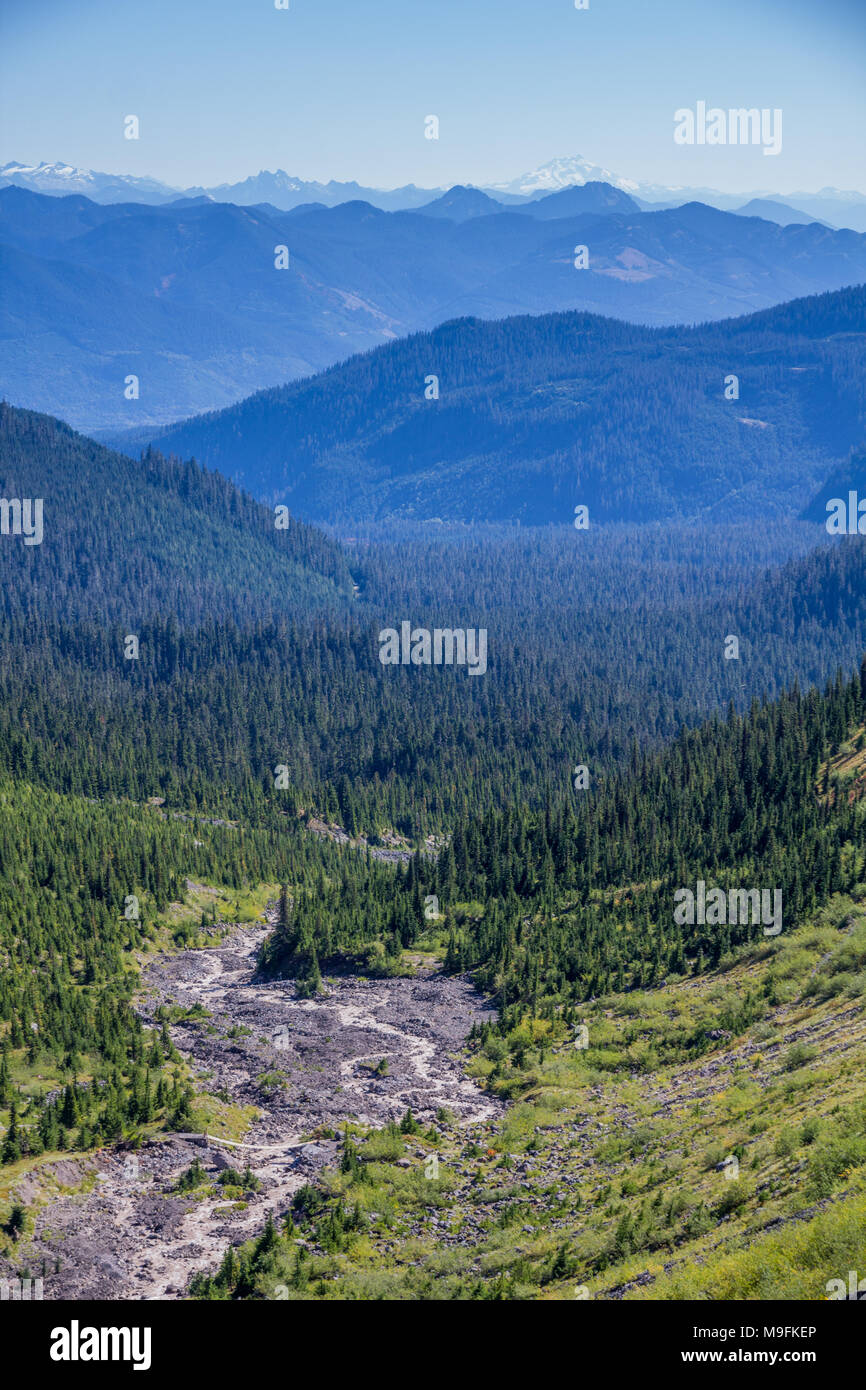 From high on southern flanks of Mount Baker, this image looks down Rocky Creek and across North Cascades to Glacier Peak on the horizon - Stock Image