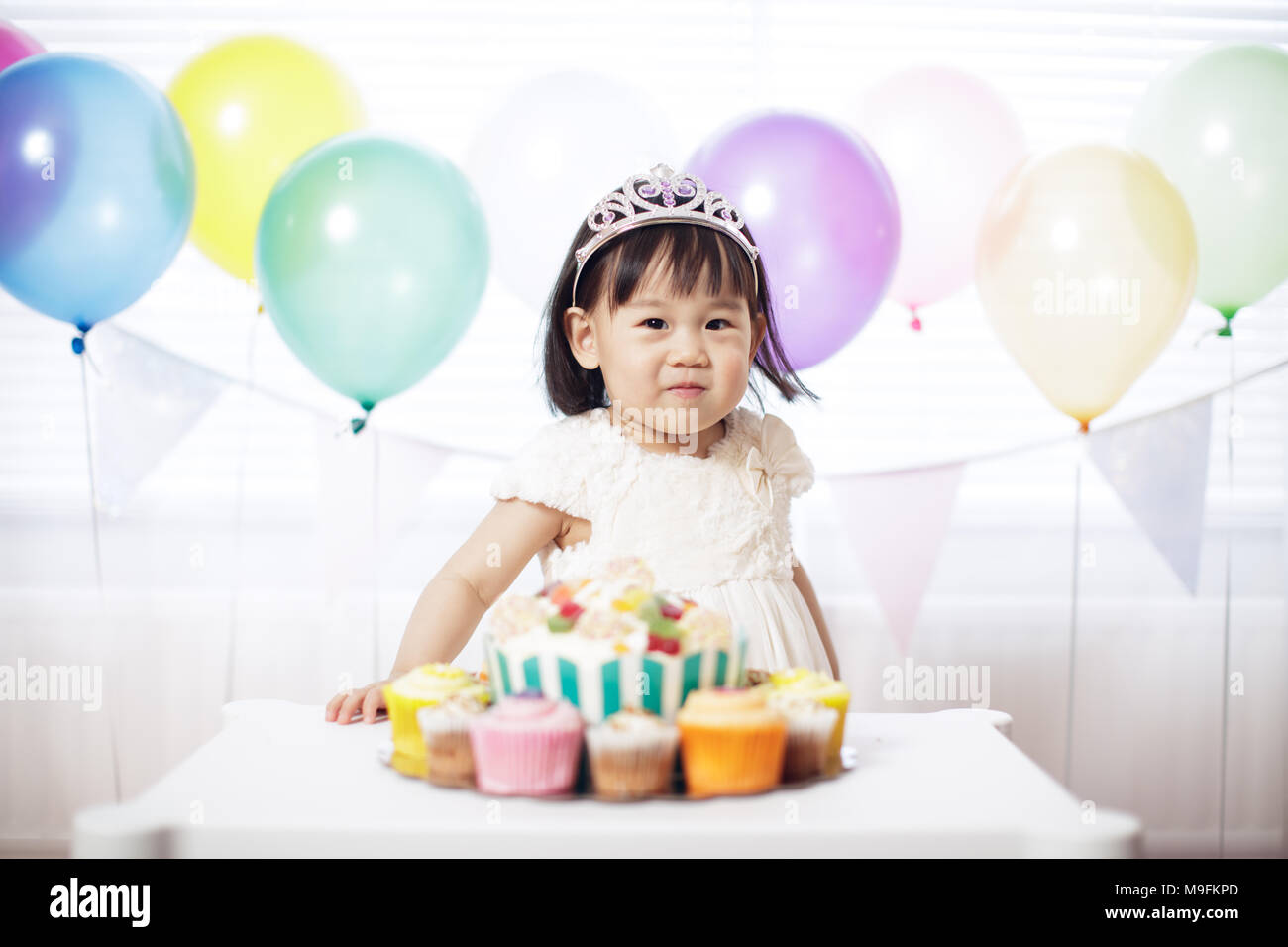 Baby girl celebrate her second birthday - Stock Image