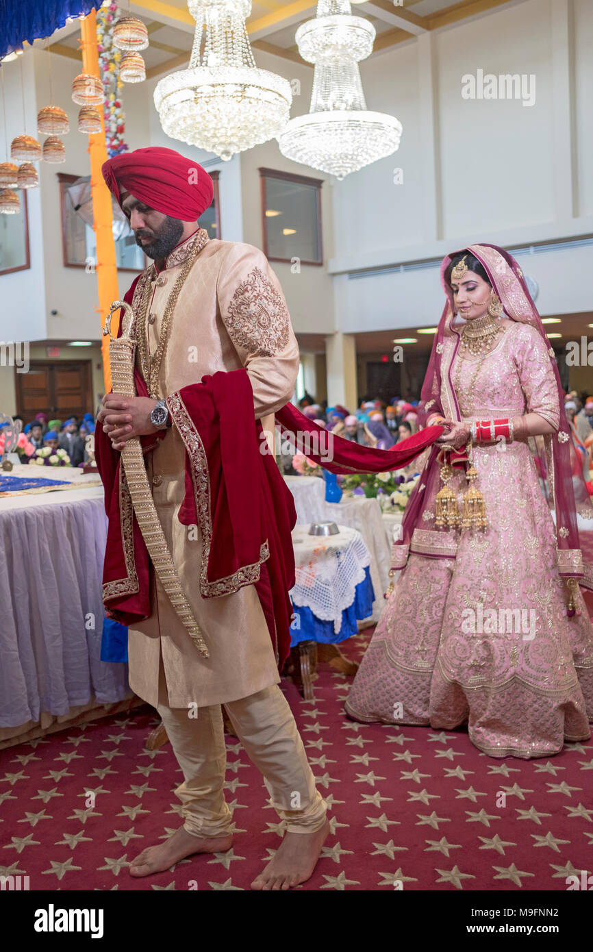 The bride and groom at a Sikh wedding ceremony in Richmond Hill, Queens New York. Stock Photo