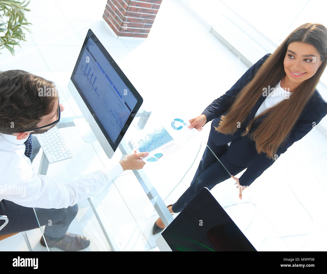 Business people in modern office - Stock Image