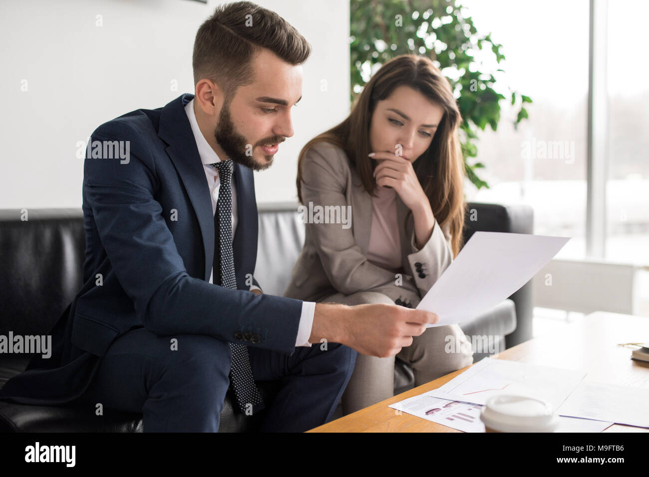 Two Modern Business People in Meeting - Stock Image