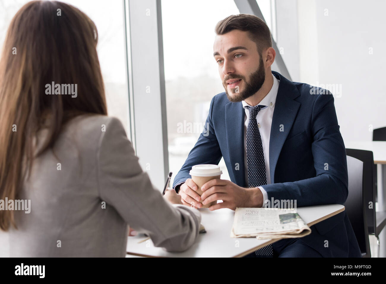 Business Couple in Cafe - Stock Image