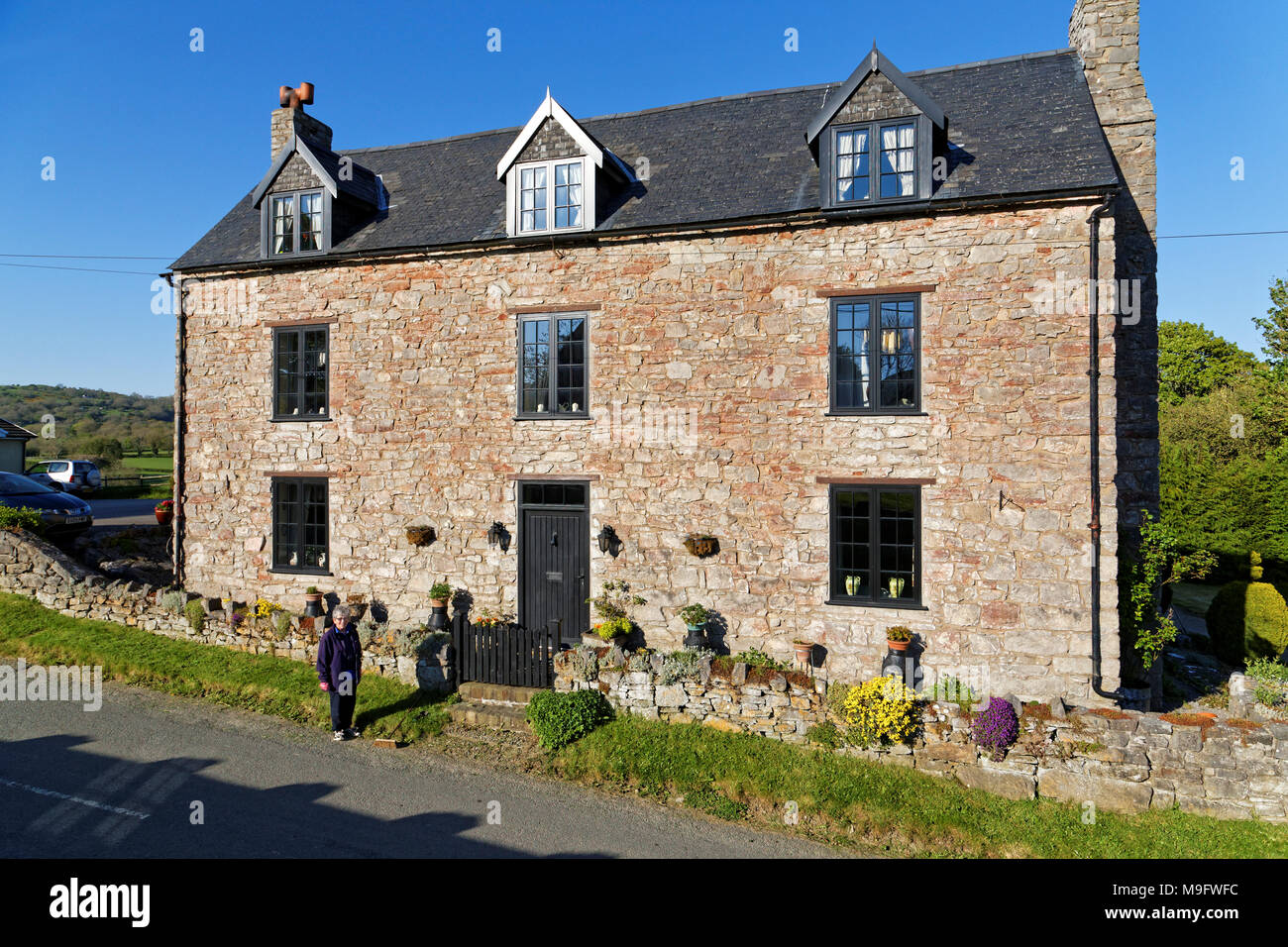 42,506.01574 longtime married woman living in a 3-story 500 yr old stone house, that was once a pub tavern - Stock Image