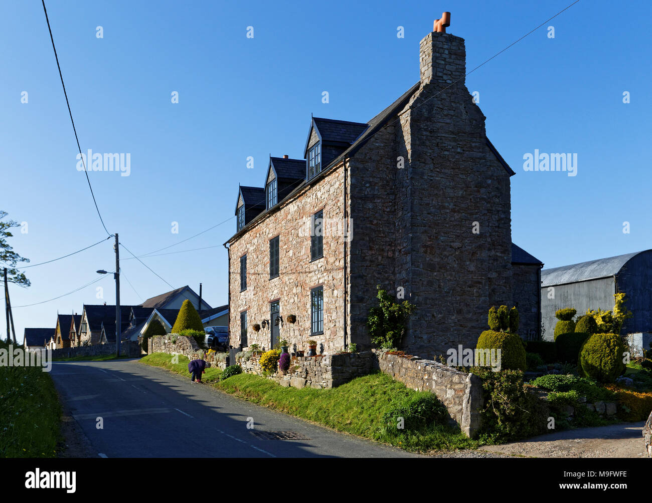 42,506.01576 longtime married woman living in a 3-story 500 yr old stone house, that was once a pub tavern - Stock Image