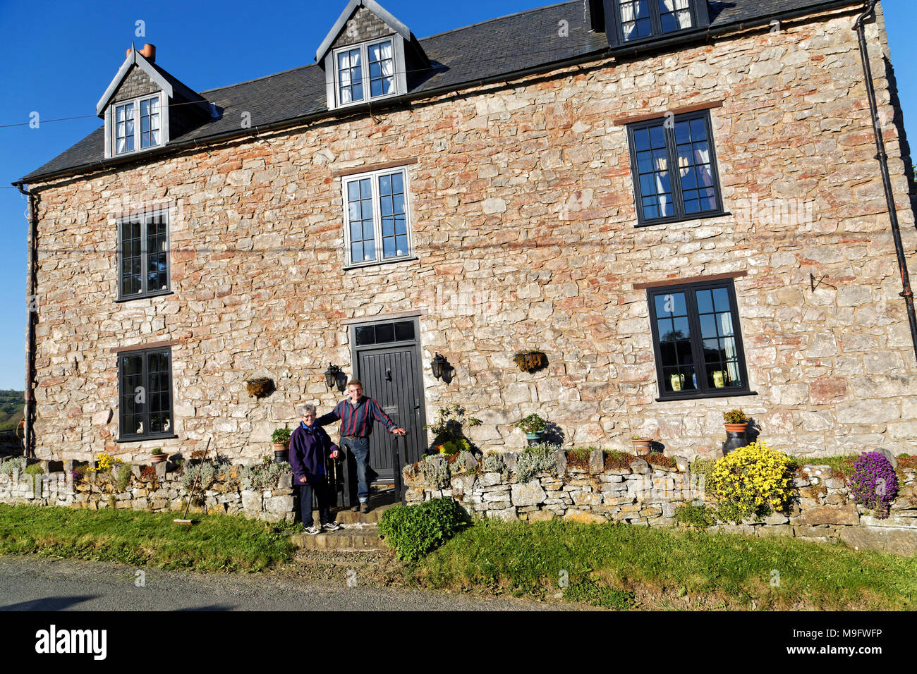 42,506.01581 longtime married couple living in a 3-story 500 yr old stone house, that was once a pub tavern - Stock Image