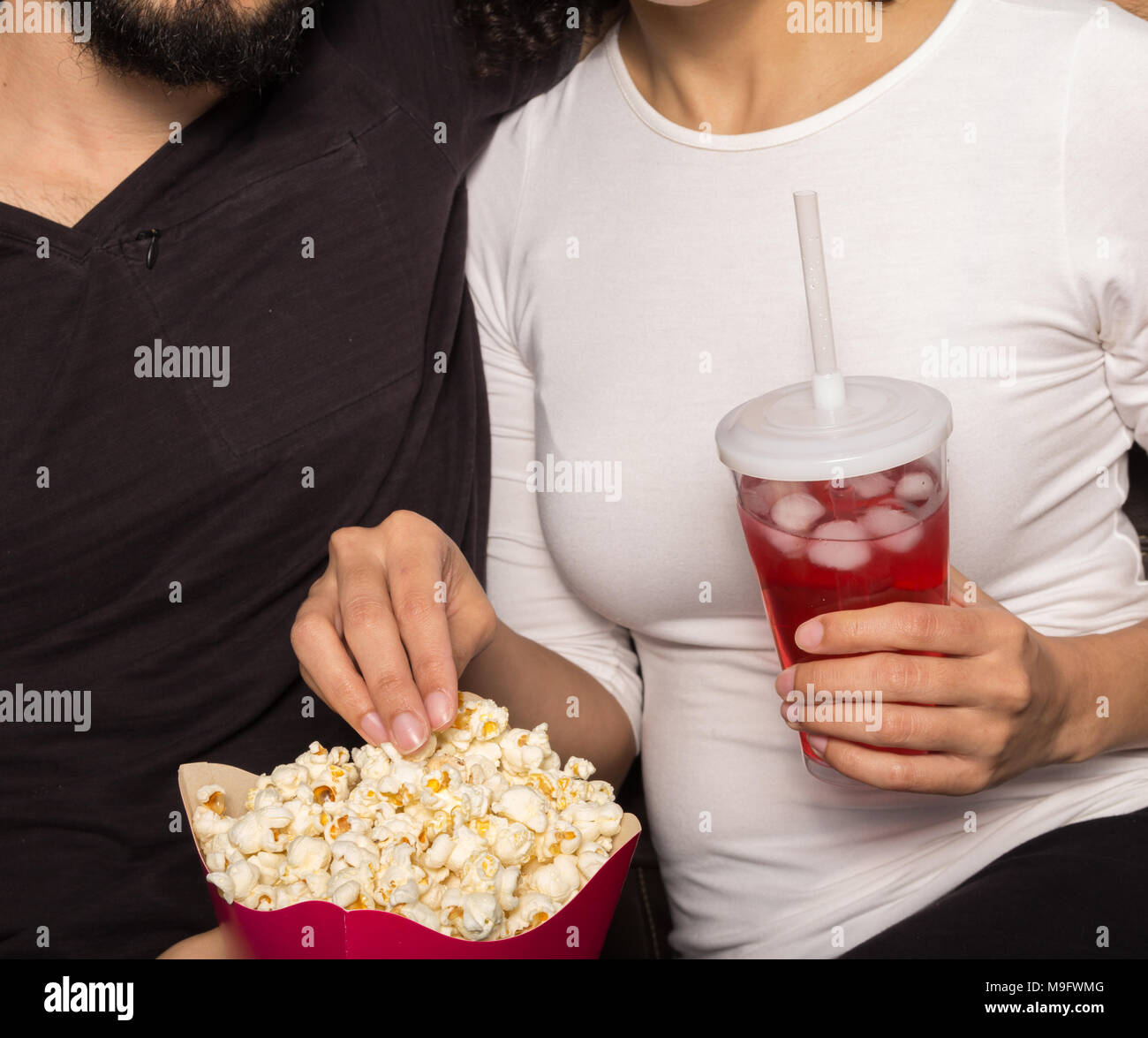 hair fair grey horror e comfortable on eating stressful sofa boy a intensed watches popcorn film the stock photo