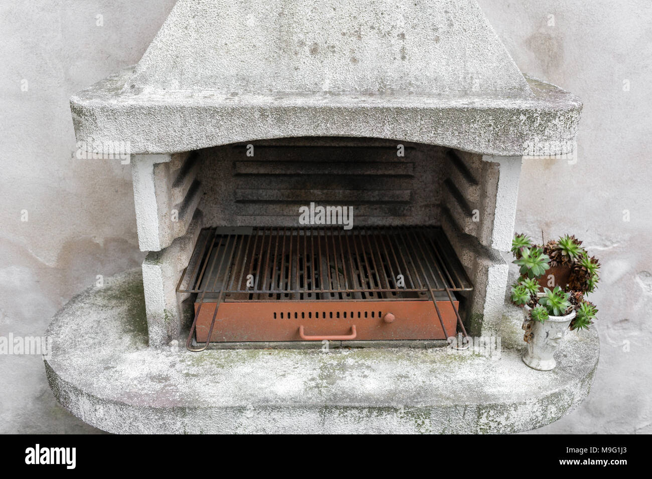 Smoky antique brick oven outdoor with ashes inside. Old garden heater. grill usable for BBQ. patio Vienna, Austria - Stock Image