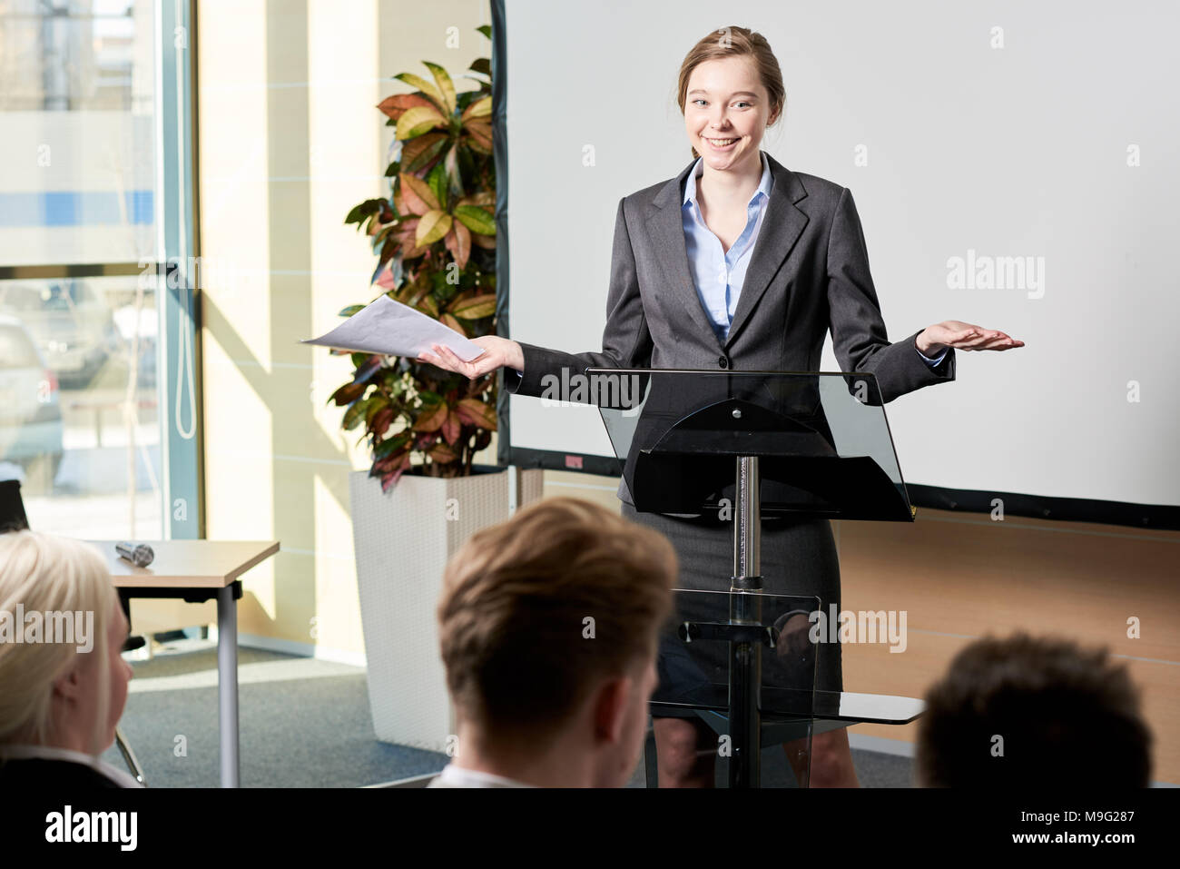 Young Businesswoman Giving Speech - Stock Image