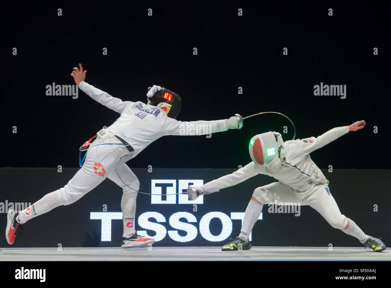 Budapest. 25th Mar, 2018. Max Heinzer (L) of Switzerland fights against Alex Fava of France during the final of the men's Epee Grand Prix in Budapest, Hungary on March 25, 2018. Max Heinzer claimed the title by defeating Alex Fava with 15-13 in the final. Credit: Attila Volgyi/Xinhua/Alamy Live News Stock Photo