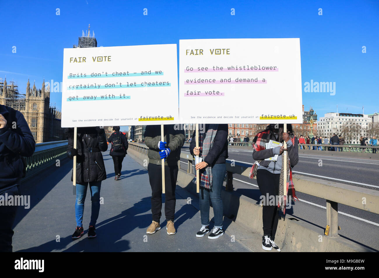 London UK. 26th March 2018. A group holding placards on Westminster Bridge by Fair Vote UK on the first anniversary of Article 50 being triggered  after new evidence emerges accusing  Vote Leave of cheating and spending breach during the European referendum campaign and of Vote Leave of improperly channelling money through a tech firm with links to Cambridge Analytic which  is also being investigated for the misuse of Facebook user data to influence electoral outcomes in Brexit and US elections Credit: amer ghazzal/Alamy Live News - Stock Image