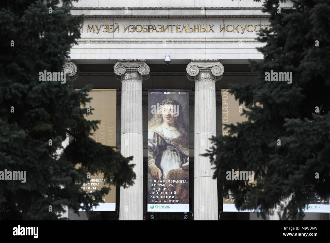 "Moscow, Russia. 26th Mar, 2018. MOSCOW, RUSSIA - MARCH 26, 2018: A poster of an exhibition titled ""The age of Rembrandt and Vermeer. Masterpieces of the Leiden Collection"" outside the Pushkin State Museum of Fine Arts. Valery Sharifulin/TASS Credit: ITAR-TASS News Agency/Alamy Live News Stock Photo"