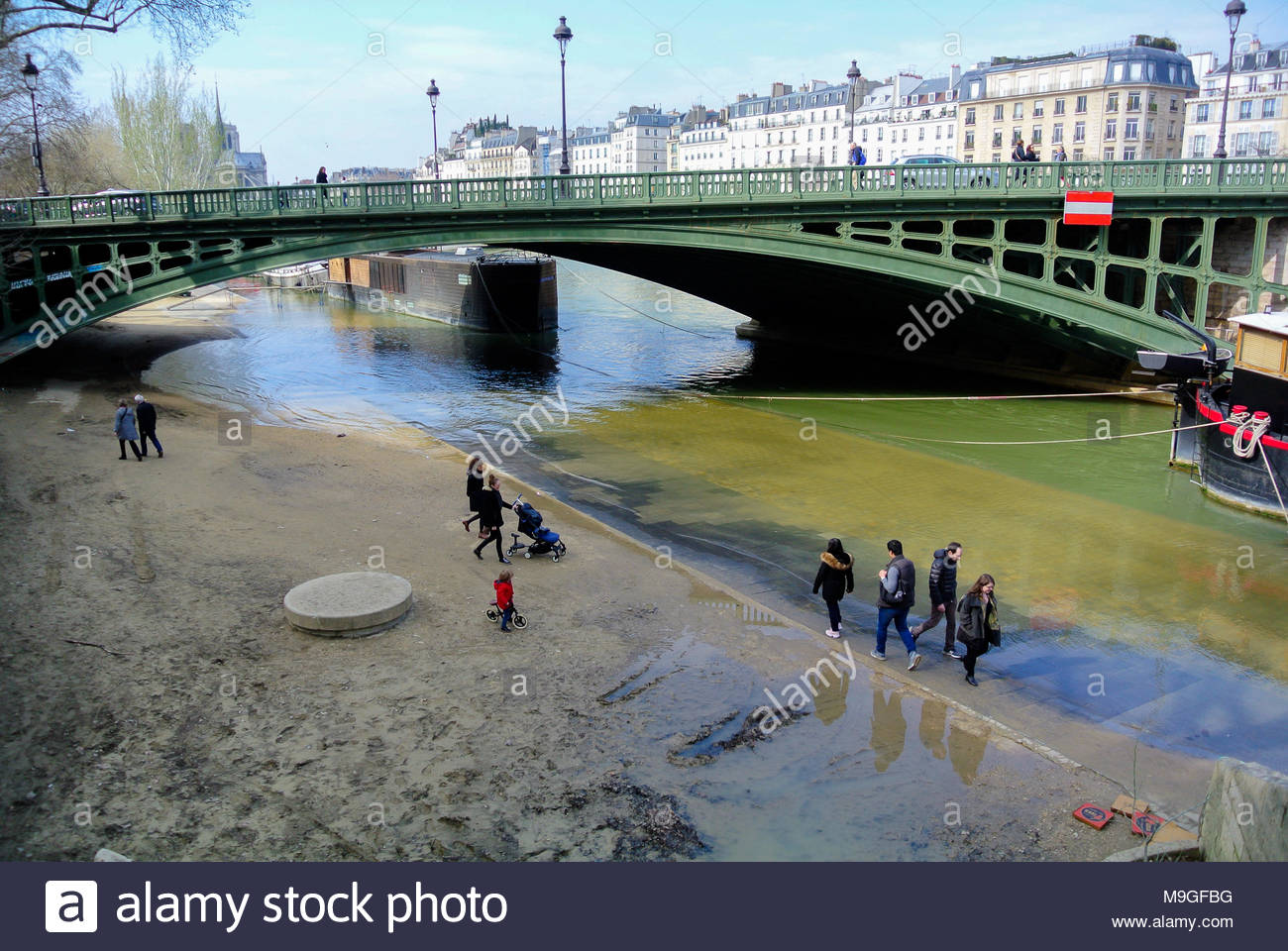 walkers seine river paris france - Stock Image