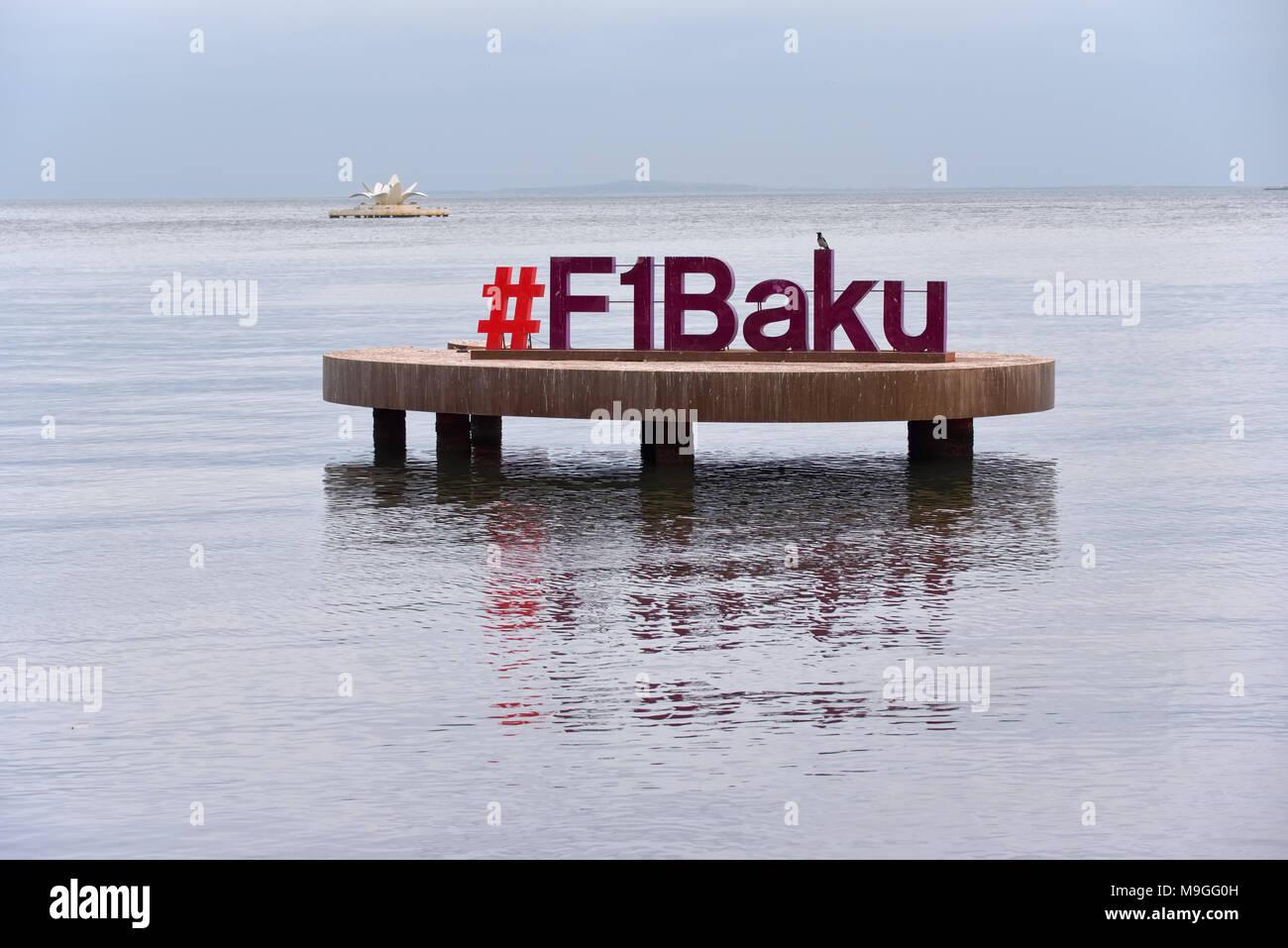 Baku, Azerbaijan - December 22, 2017: Formula 1 sign over water on cloudy December early evening at Bay of Baku in Baku, Azerbaijan. - Stock Image