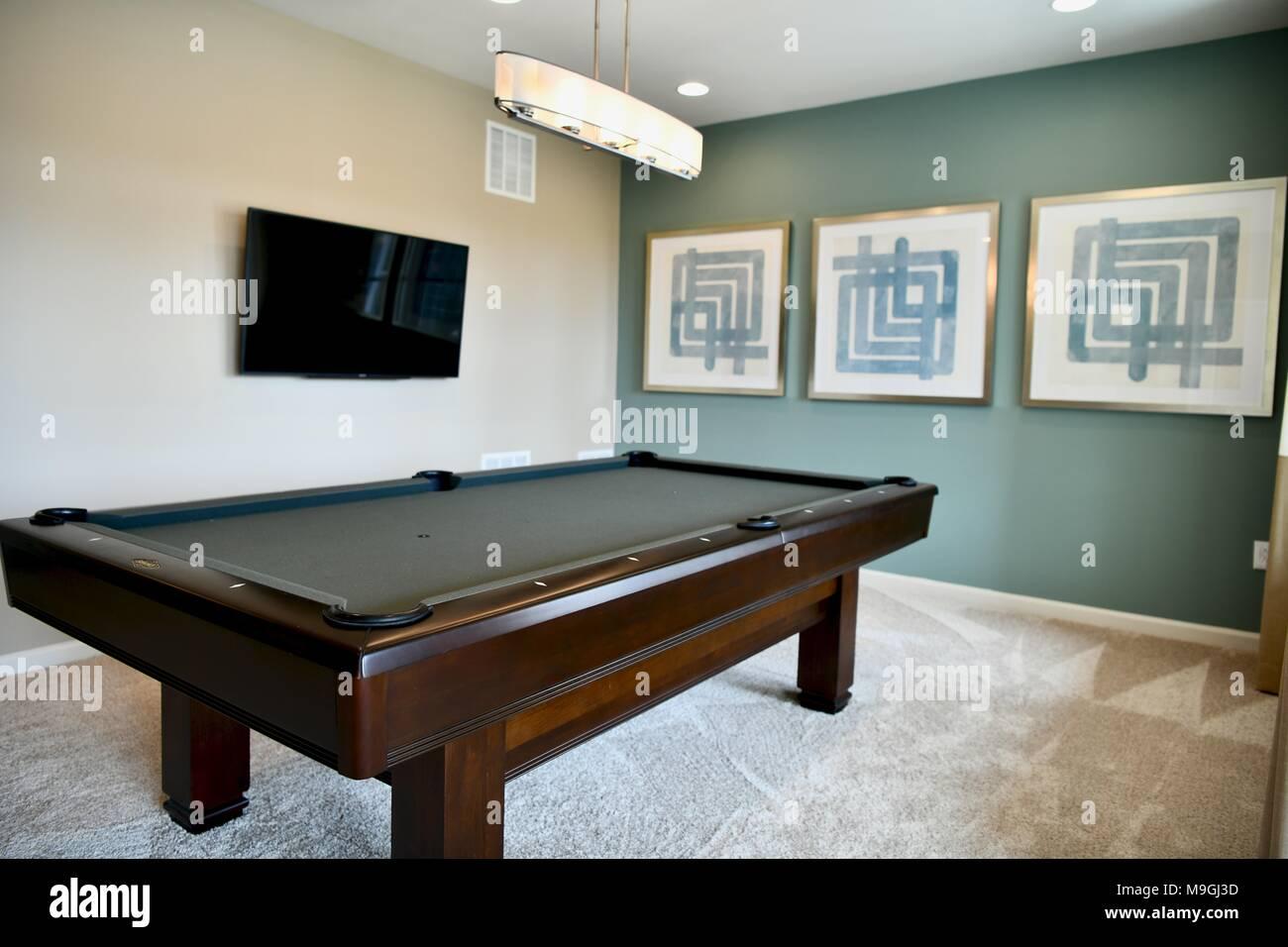 Pool table inside modern home living room Stock Photo ...
