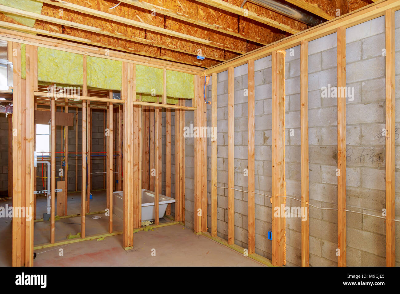 Remodeling a home bathroom moving plumbing for new sinks Interior wall framing with piping installation in the basement & Remodeling a home bathroom moving plumbing for new sinks Interior ...