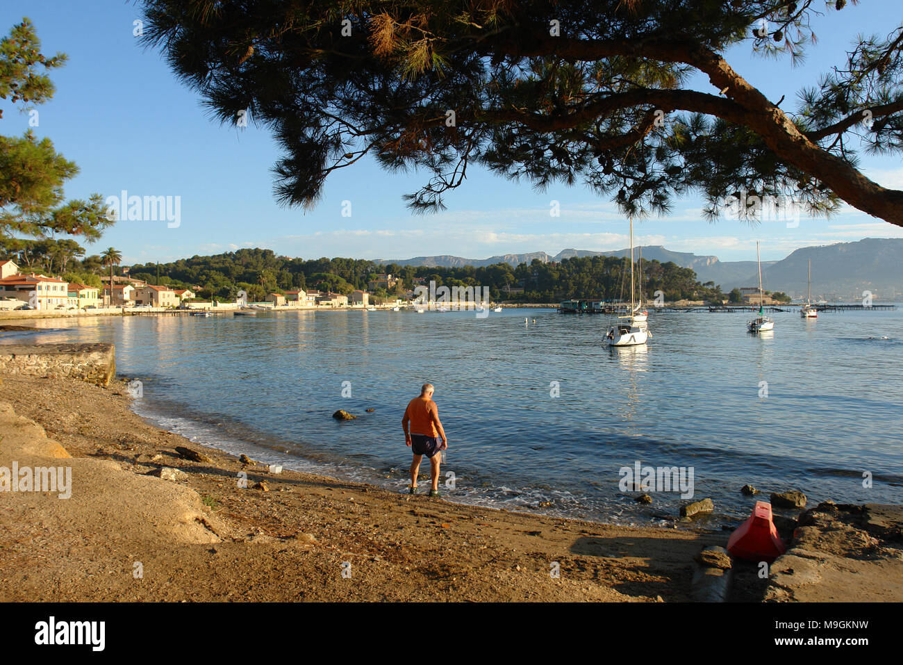 Bather to the natural harbour of Balaguier - Stock Image