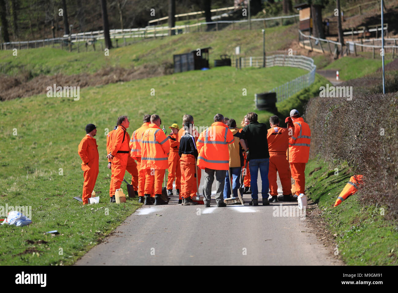 Motor sport marshals being trained in dealing with fluid spills. - Stock Image