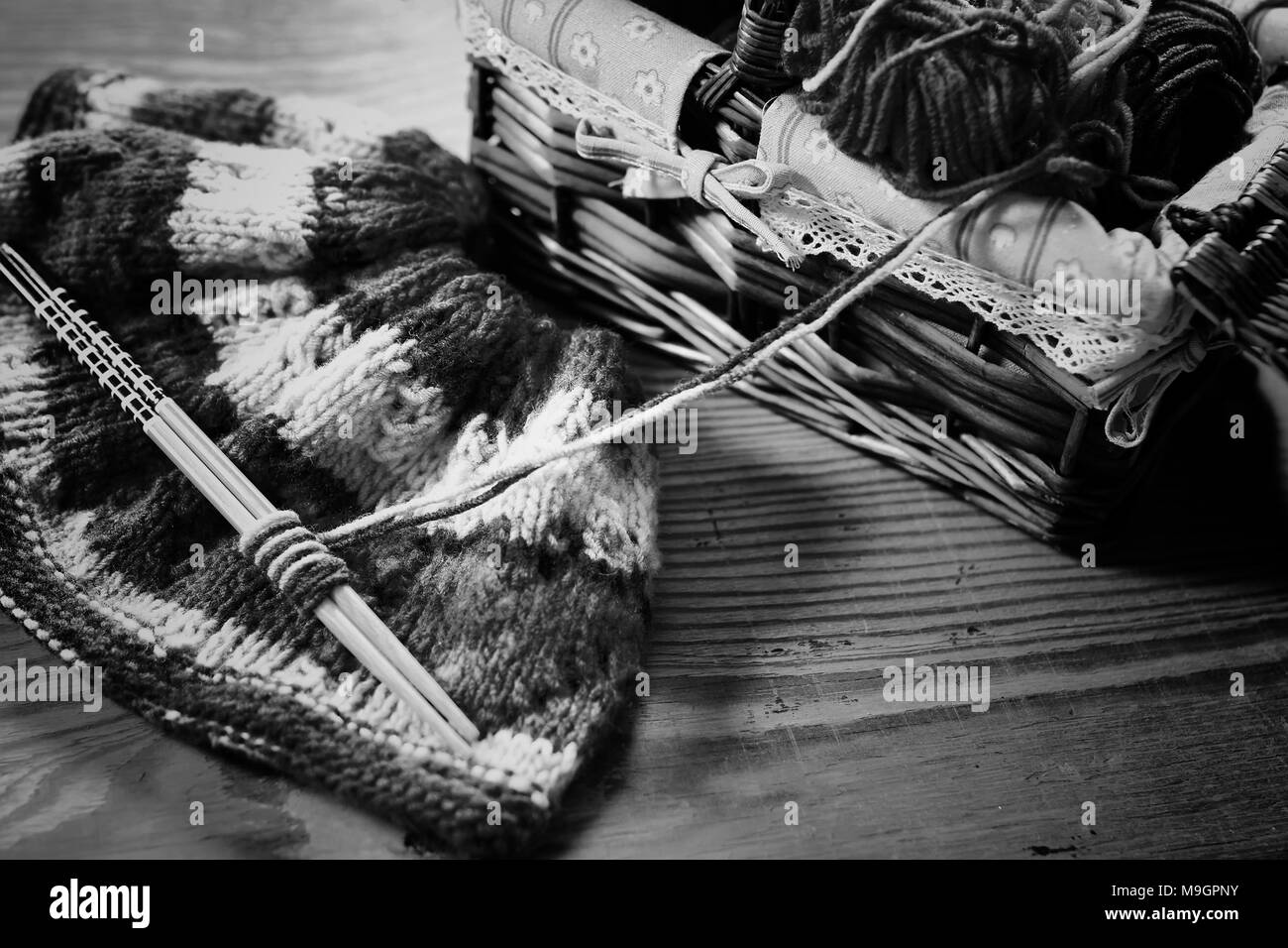 monochrome wool and knitting needles  - Stock Image