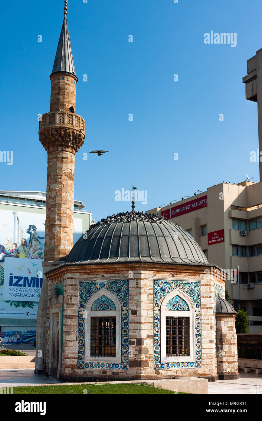 IZMIR, TURKEY - OCTOBER 04, 2014: Yali Mosque called Konak Mosque, famous octagonal shaped landmark at the Konak Square, built in 1755. Dome and minar Stock Photo