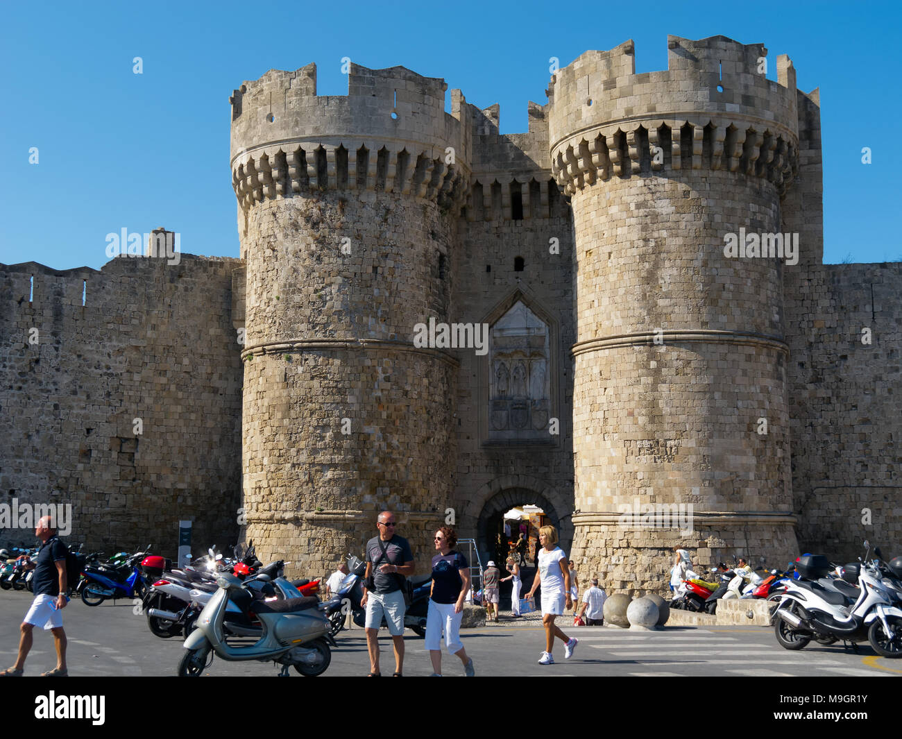 RHODES CITY, GREECE - SEPTEMBER 30, 2011:  Tourists admite Towers of Marine Gate of Old Town, ancient fort of  Rhodes Island Stock Photo