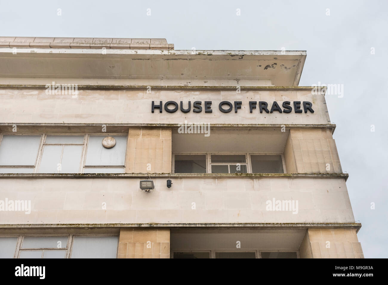 House of Fraser Plymouth, closing. Metaphor struggling retailers, high street squeeze, House of Fraser shop closures, high street spending drop Stock Photo