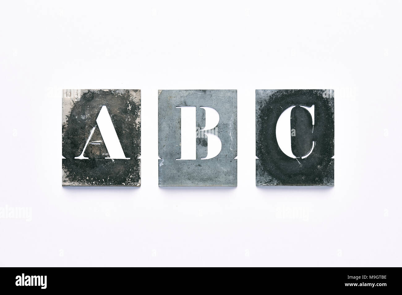 Letter Addressing Stencil.Metal Letter Stencil A B C On White Background Stock Photo