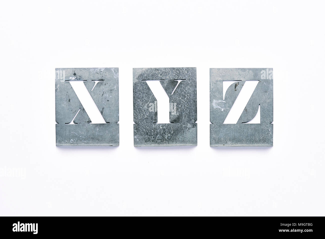 Metal stencil letters X, Y, Z on a white background - Stock Image