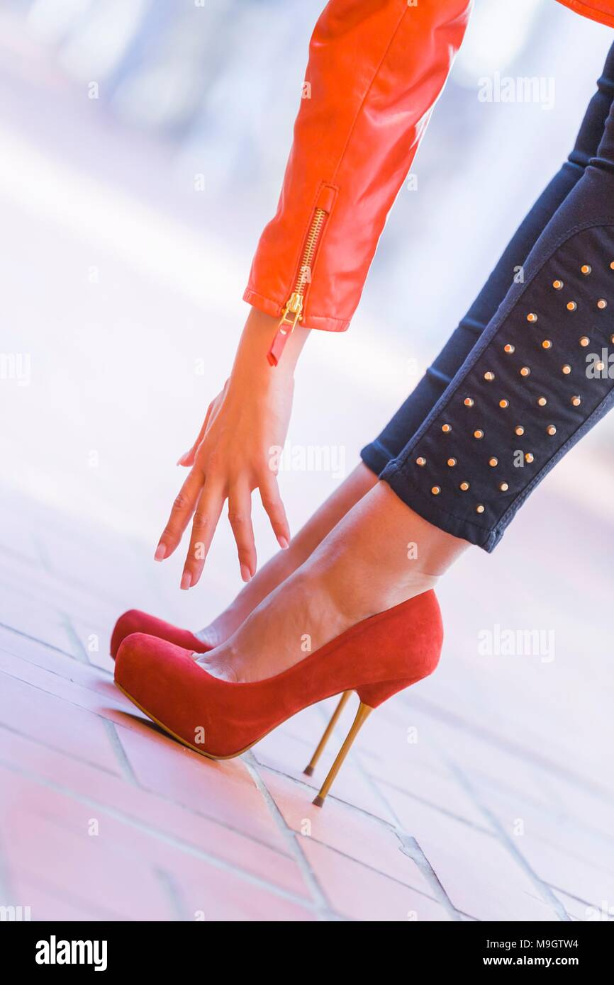 Young woman legs heeled spike spiked shoes high heels out difficult to reach Stock Photo