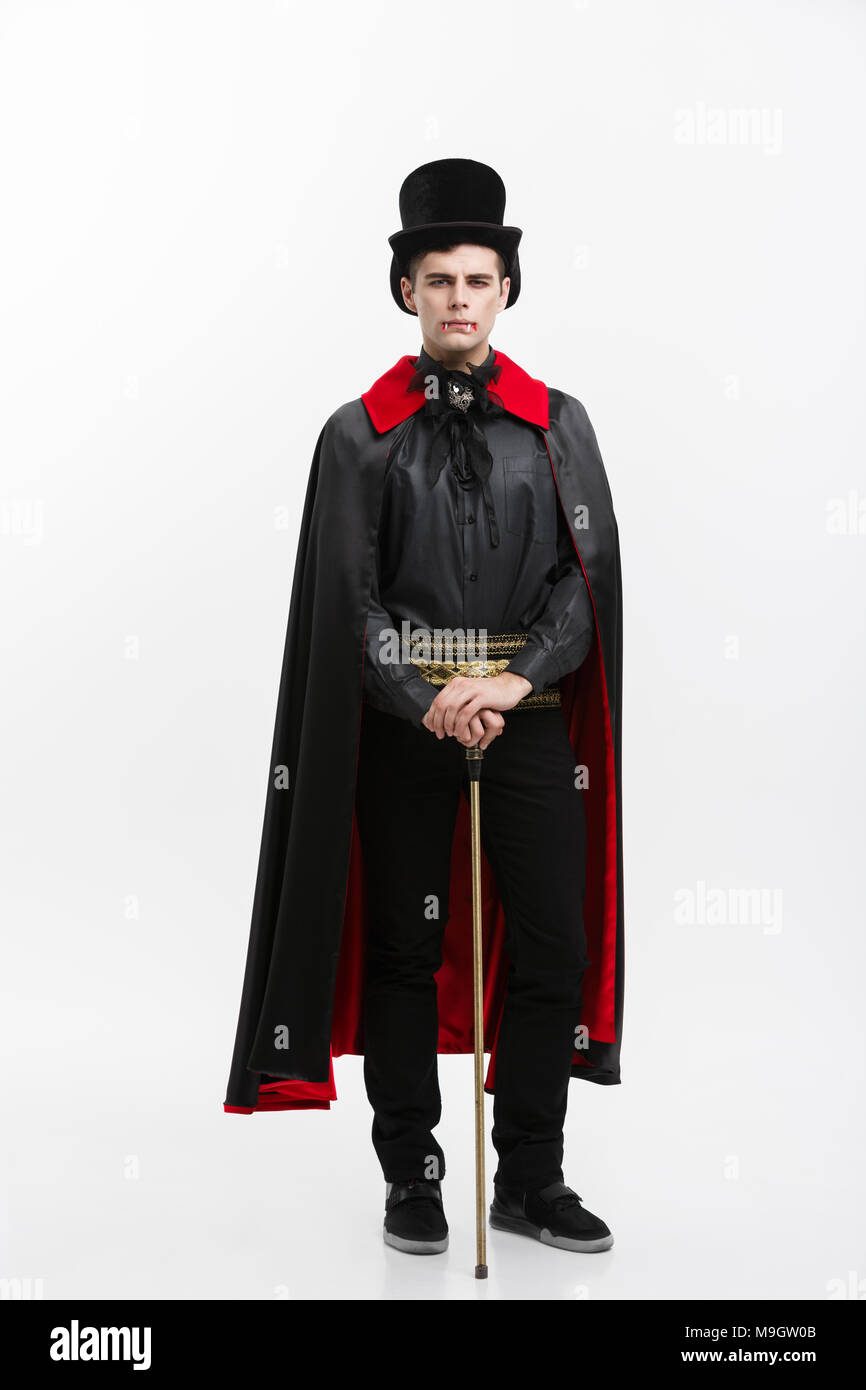 V&ire Halloween Concept - Full length Portrait of handsome caucasian V&ire in black and red halloween costume.  sc 1 st  Alamy & Vampire Halloween Concept - Full length Portrait of handsome ...