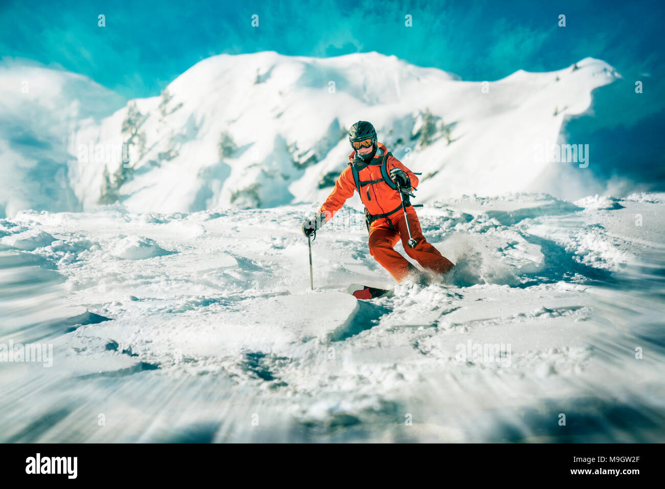 Female skiers action skiing in deep snow - Stock Image
