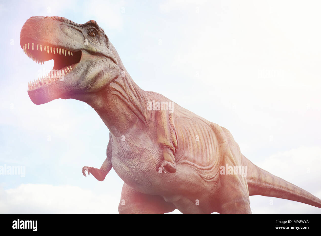 Park of dinosaurs. A dinosaur on the background of nature. Toy d - Stock Image