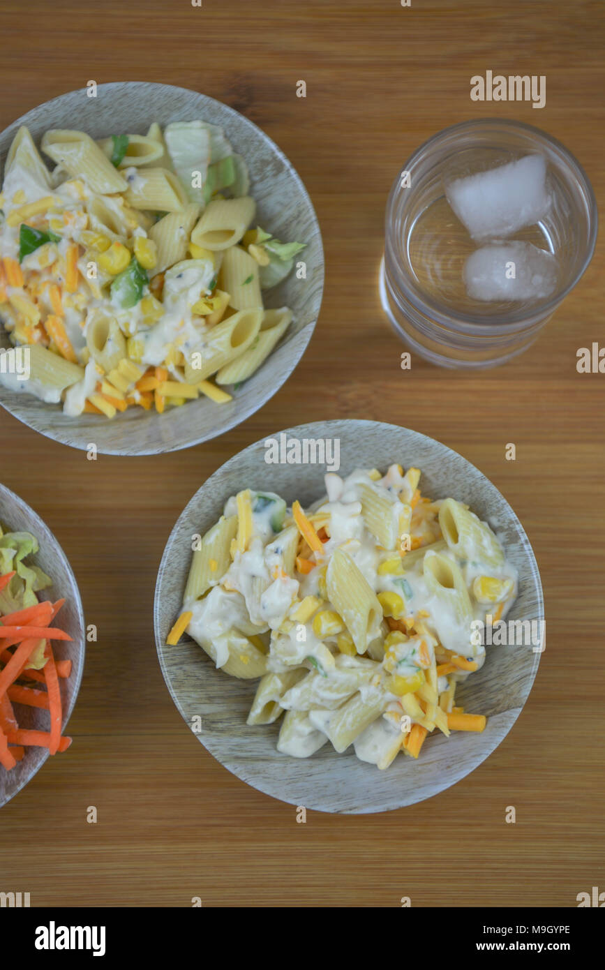 flat lay with fresh pasta salad for lunch on a desk or table - Stock Image