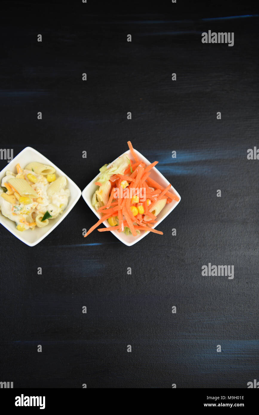 flat lay with dishes of pasta salad - Stock Image