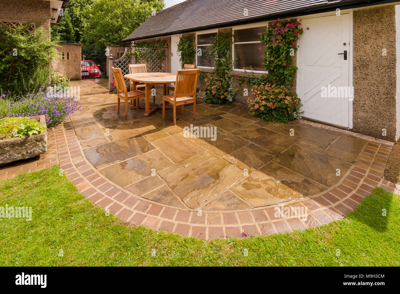 Designed Landscaped Garden With Curved Paved Patio Lawn