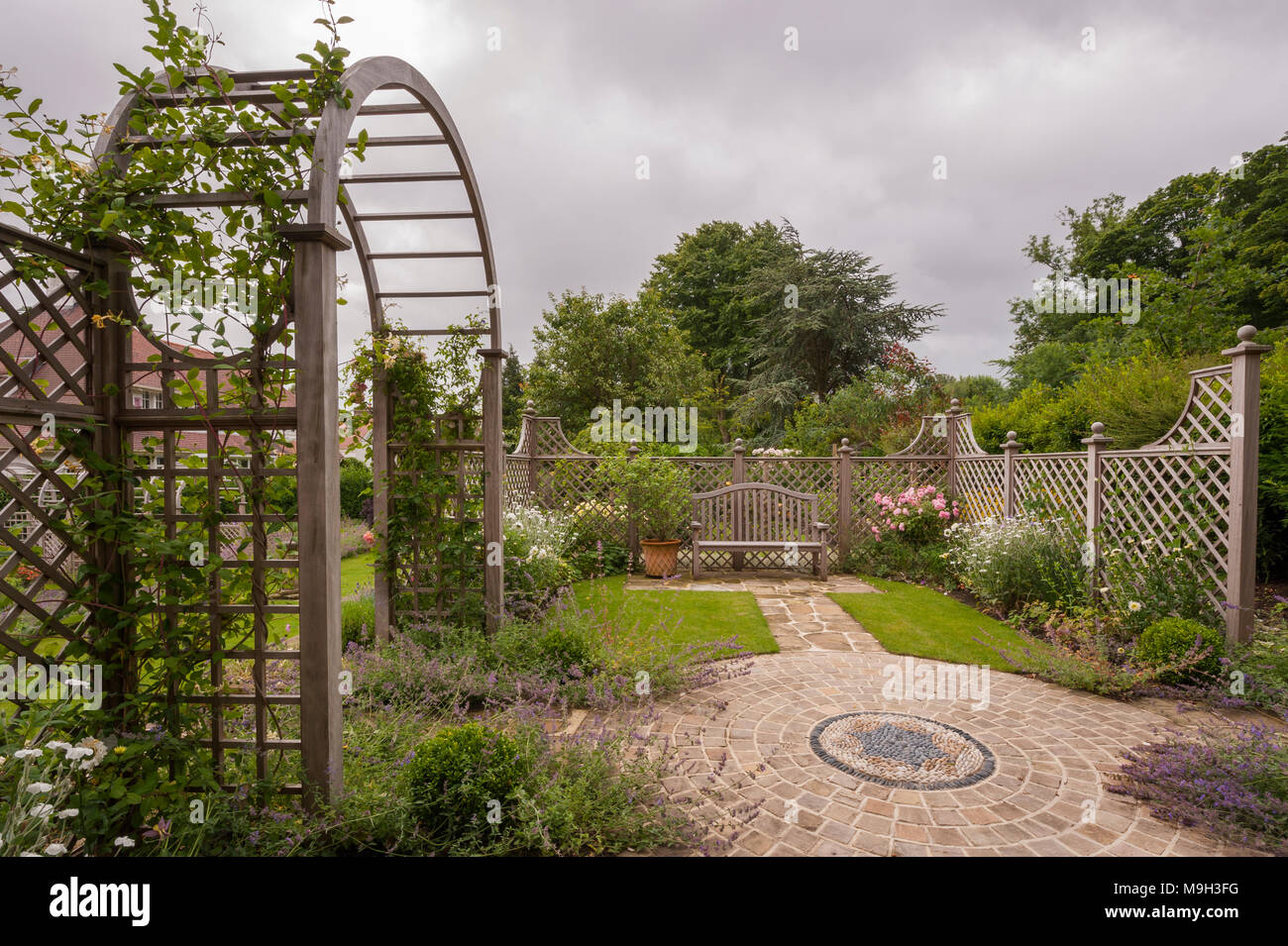 Summer plants, mosaic artwork, trellis screen, arbour archway & seat ...