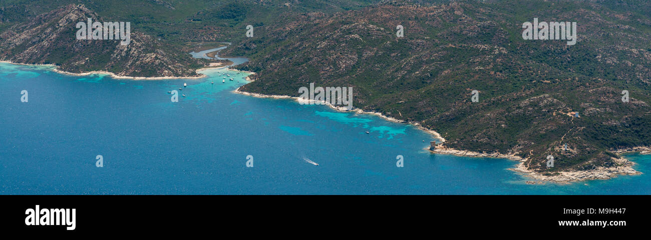 Aerial image of turquoise blue waters at the Corsican coastline West of Saint-Florent showing Punta Cavallata and Plage du Lotu, France Stock Photo