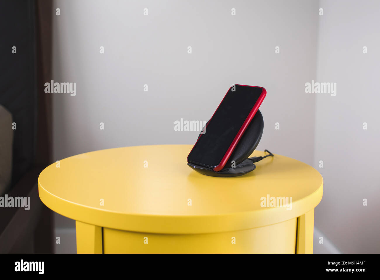 Smartphone on a wireless fast charger station - Stock Image
