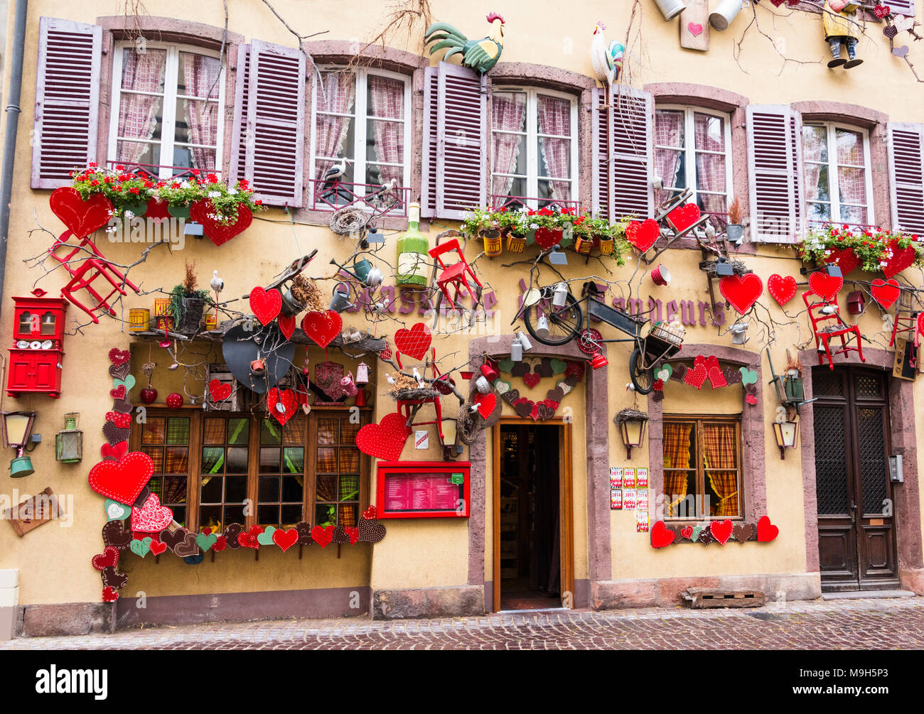A traditional restaurant in the old town of Colmar, Alsatian Wine Route, France - Stock Image