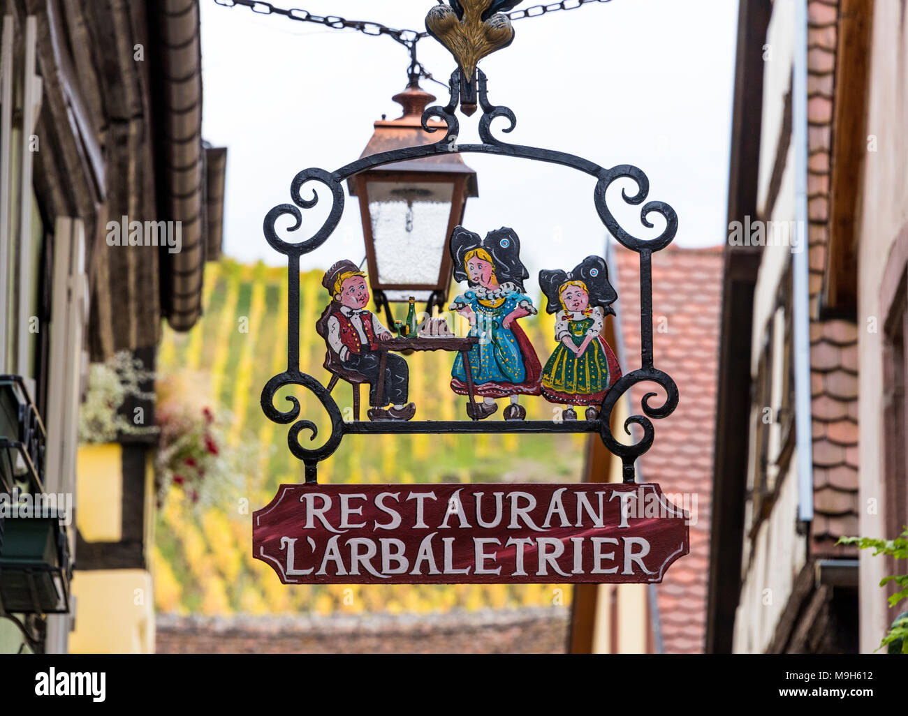 Restaurant sign in the medieval town of Riquewihr, Alsatian Wine Route, France - Stock Image
