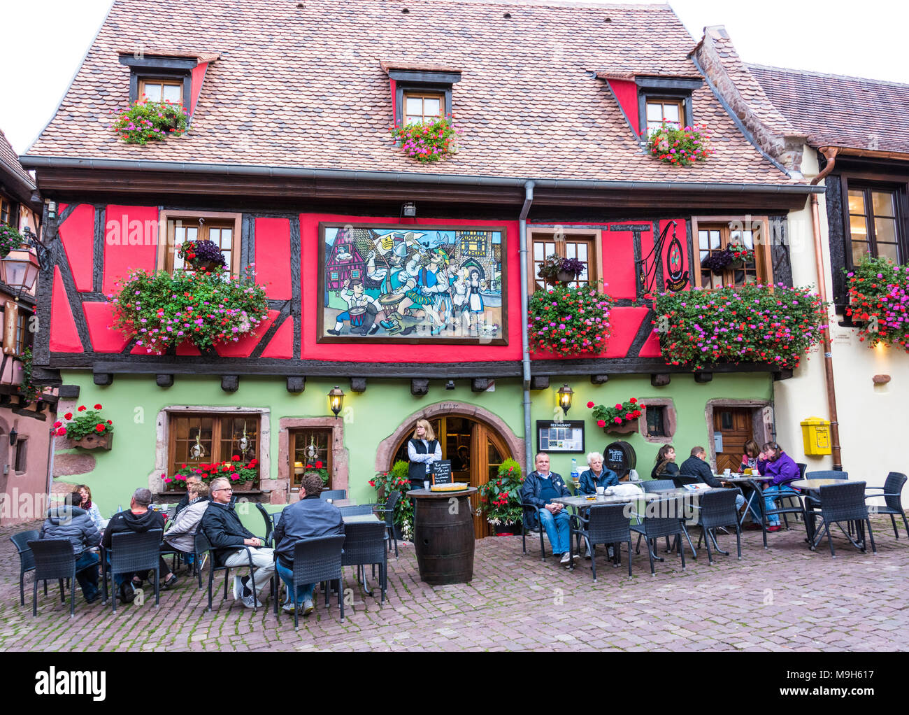 Traditional restaurant in the medieval town of Riquewihr, Alsatian Wine Route, France - Stock Image