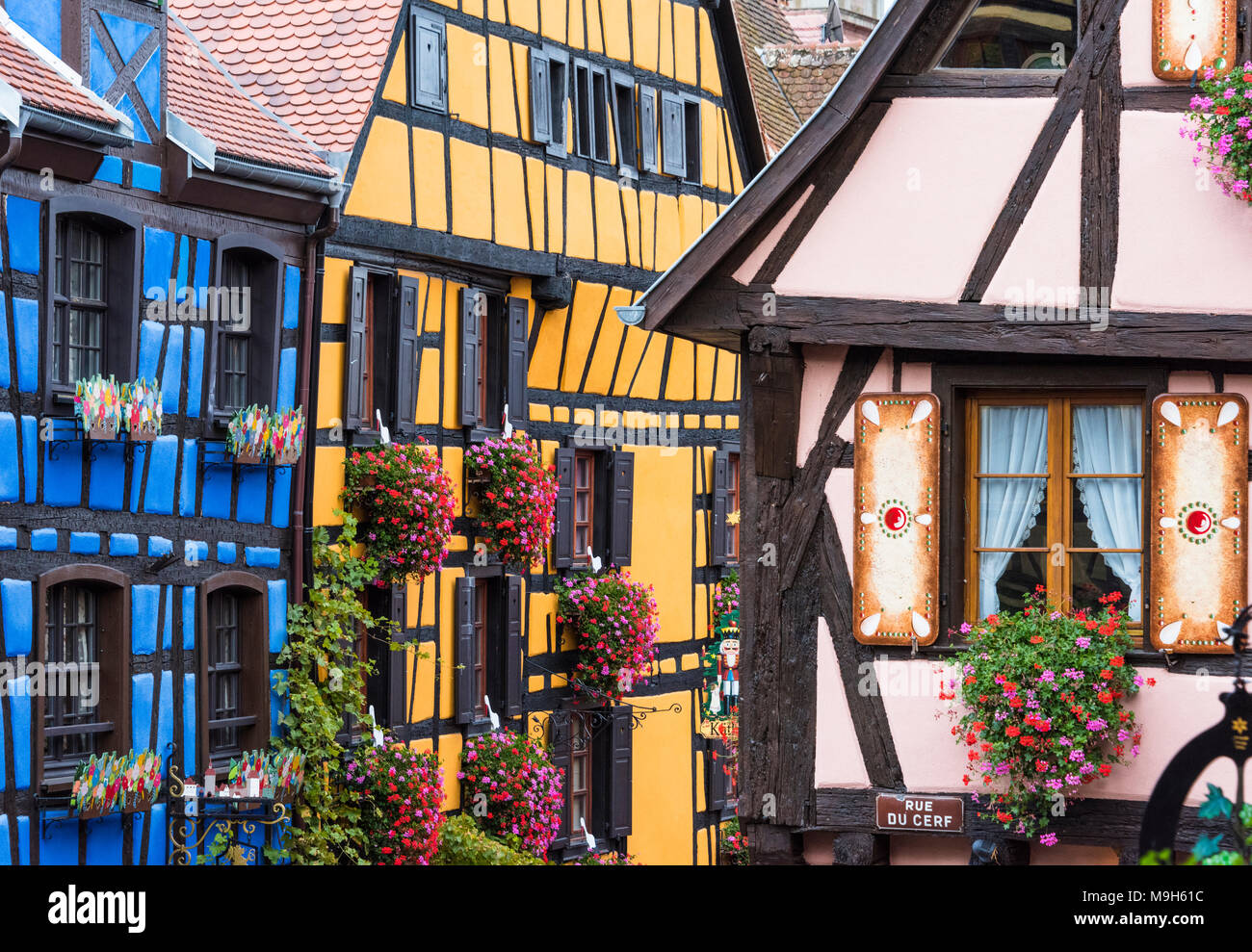 Half-timbered houses of the medieval town of Riquewihr, Alsatian Wine Route, France - Stock Image