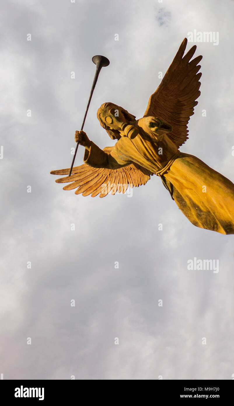 Statue of one of the Seven Angels of the Apocalypse wearing a gas mask - Stock Image