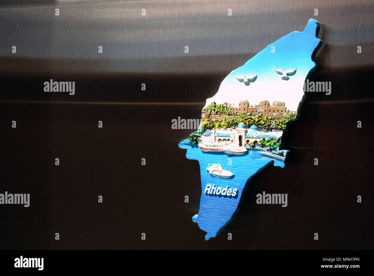 A fridge magnet from Rhodes, Greece in the shape of the actual island. - Stock Image