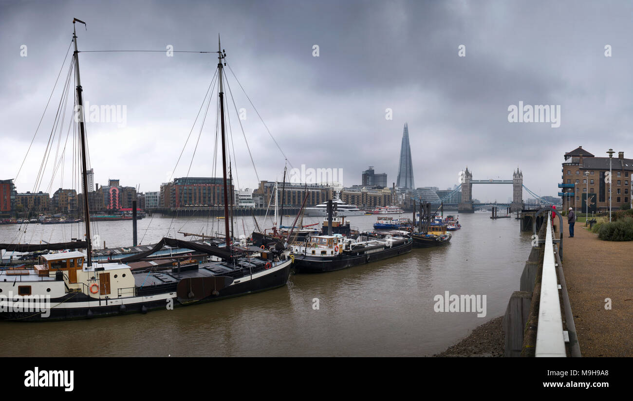 Tower Bridge and the River Thames view showing The Shard photographed from Wapping on north shore of the river. March 2018 - Stock Image