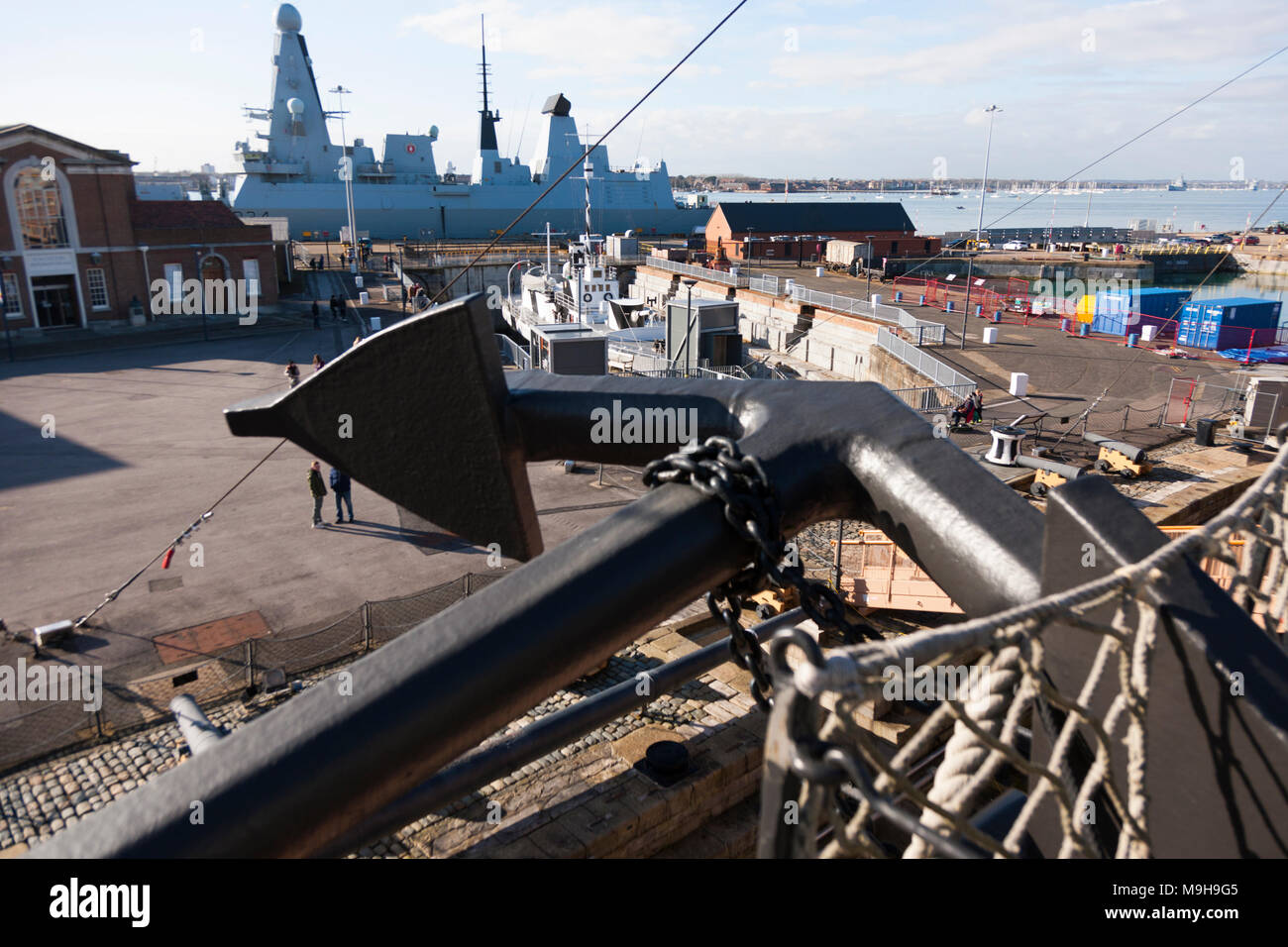 View over anchor on starboard side of Admiral Lord Nelson's flagship HMS Victory of Portsmouth Historic Dockyard / Dockyards / docks & HMS Diamond. UK - Stock Image