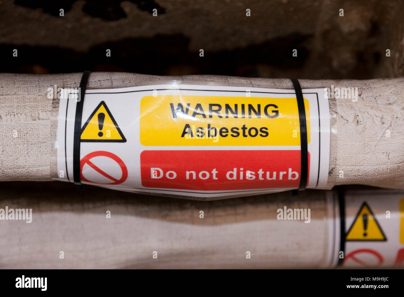 Warning asbestos do not disturb sign on an old retired first world war WW1 naval ship. (95) - Stock Image