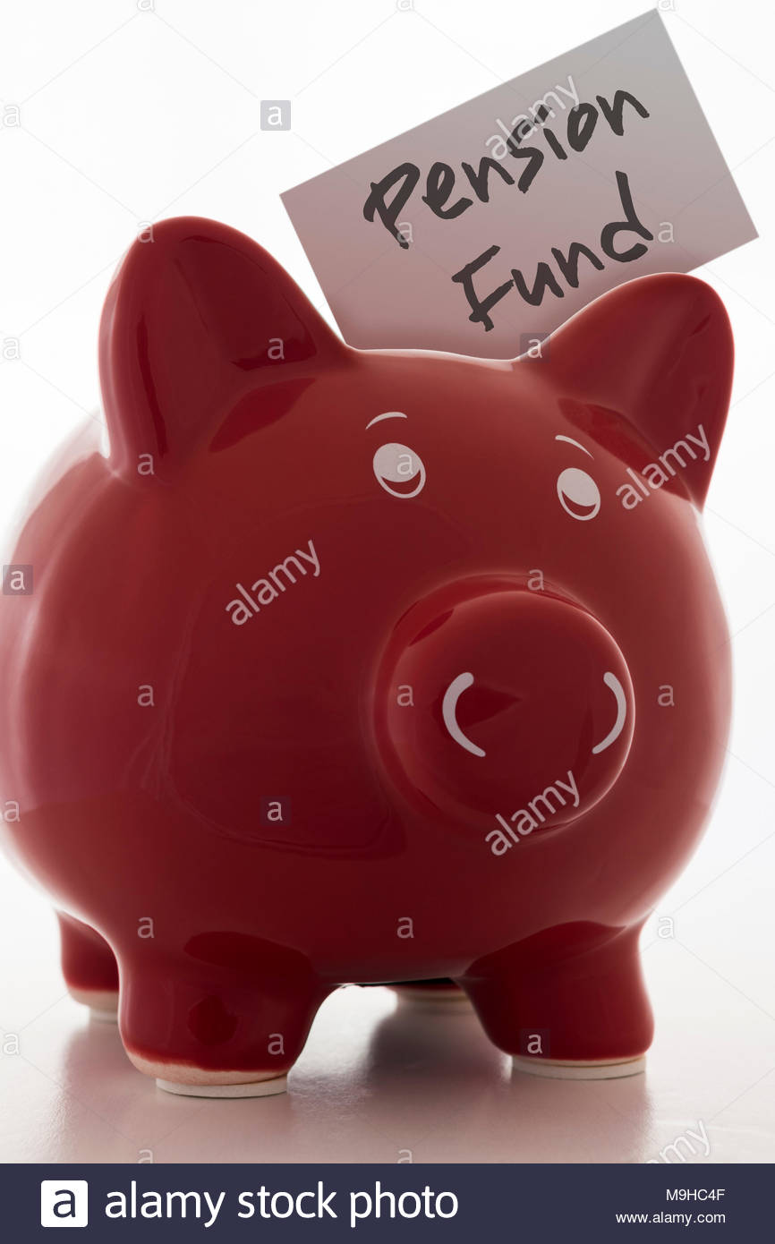 Red Piggy Bank (Money Box) with the label Pension Fund - Stock Image